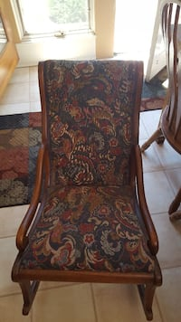 red and green floral fabric padded brown wooden framed rocking chair Centreville, 20121