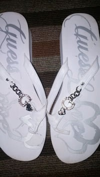 Guss white sandals with a silver chain on top   Toronto, M3M 2T2