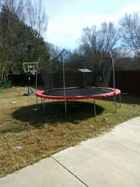 red and black trampoline with enclosure Dallas, 75217