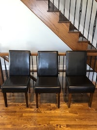 3 black faux leather chairs. Ottawa, K1L 6S7