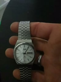 round silver analog watch with link bracelet null