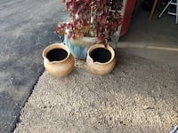 two beige clay pots