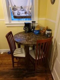 round brown wooden table with four chairs dining set 354 mi