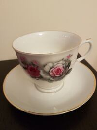 white, gray, and pink ceramic teacup with saucer