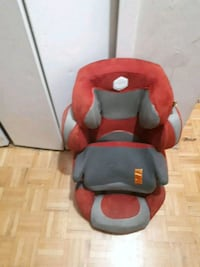 red and black car seat carrier 544 km