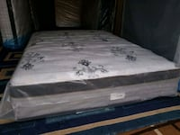 white and gray floral mattress bed