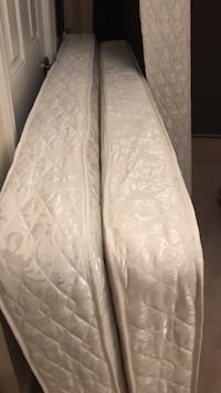 White twin mattresses (2) with box springs. Also have 2 metal bed frames.  Will include or sell separately   Highland Park, 60035