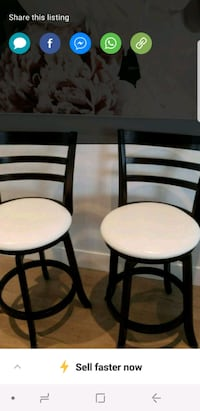 Two dark brown framed white leather stools