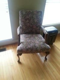 black and gray floral padded armchair