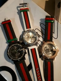 two round black and red analog watches Victoria, V8Z
