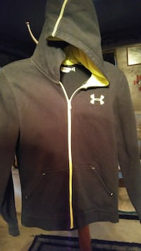 In new condition under armour youth hooded jacket