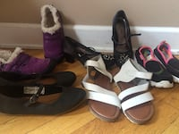 pair of women's black, purple, and white shoes
