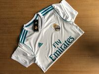 white and blue Real Madrid FC jersey