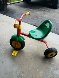toddler's green and red trike