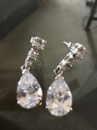 Pair of silver-colored earrings with clear gem stones Calgary, T2Y 2J1