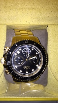 round black chronograph watch with silver link bracelet Dallas, 75233