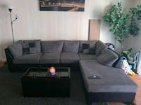 black fabric sectional sofa with throw pillows Silver Spring, 20904