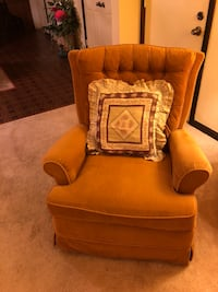 brown wooden framed brown padded armchair 24 mi