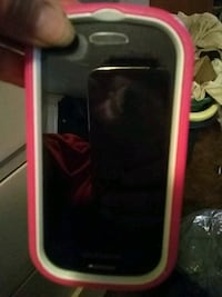 black android smartphone with pink case Bakersfield, 93308