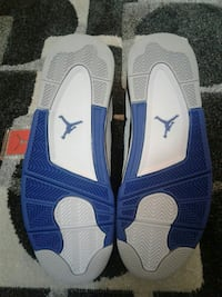 white-and-blue Air Jordan basketball shoes