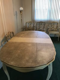 oval brown wooden dining table with chairs set Drexel Hill, 19026