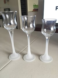 three footed clear glass candle holders