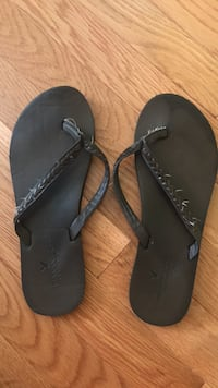 pair of black flip-flops Gainesville, 20155