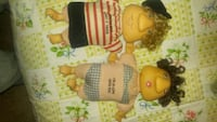 two white and red dressed dolls 693 mi