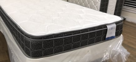Twin pillowtop mattress and box spring.  BRAND NEW IN SEALED PLASTIC