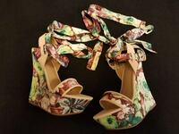 pair of white-and-green floral wedge shoes Oakland, 94610
