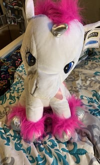 Pink haired unicorn stuffed animal