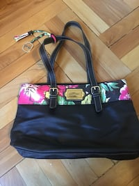 """Black Ellen Tracy purse handbag. Has a wideband of flowers and leaves on the top. Fully lined with pockets. Measures 14"""" x 9"""". Excellent condition. Upland, 91786"""
