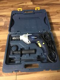 Black and gray power tool set in case.. Edmonton, T5E 5Y6