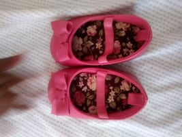 pair of pink floral slip on shoes