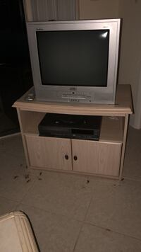 gray CRT television with white wooden TV stand