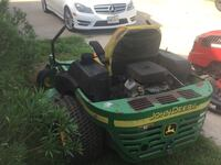 green and black ride on mower Brazoria, 77422