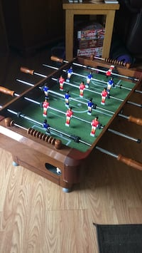 Brown and green foosball table Victoria, V9A 6Y1