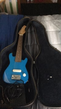 blue and black electric guitar Canton, 44706