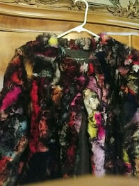Fur jacket with tags size M  8-10.  Multi colored beautiful cost $350