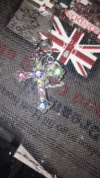 green, purple, and pink gemstone embellished silver cross pendant