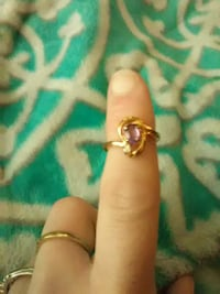 gold-colored ring with purple gemstone Shoreline, 98133