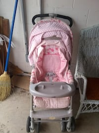 baby's gray and pink stroller