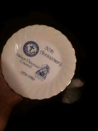 white and blue ceramic plate with gold lining Calgary, T3G 4N1