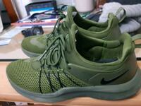 pair of green-and-gray Nike running shoes