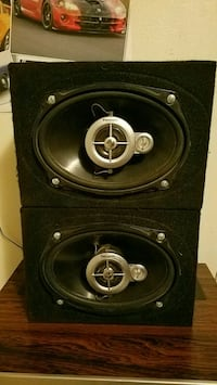 two black-and-gray coaxial speakers