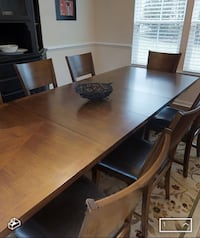 Rectangular brown wooden dining table with 8 padded chairs Concord, 28027