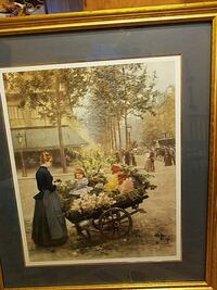 Lady in blue dress with child in flower cart