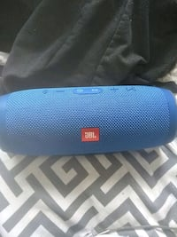blue JBL portable Bluetooth speaker 3157 km