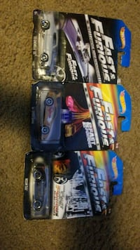 two black and blue RC car toys 537 mi