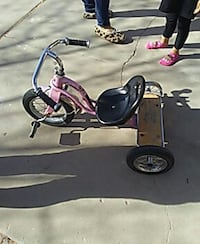 children's pink and black trike